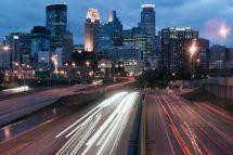 Night has fallen over Minneapolis Minnesota as rush hour traffic still moves on the highways